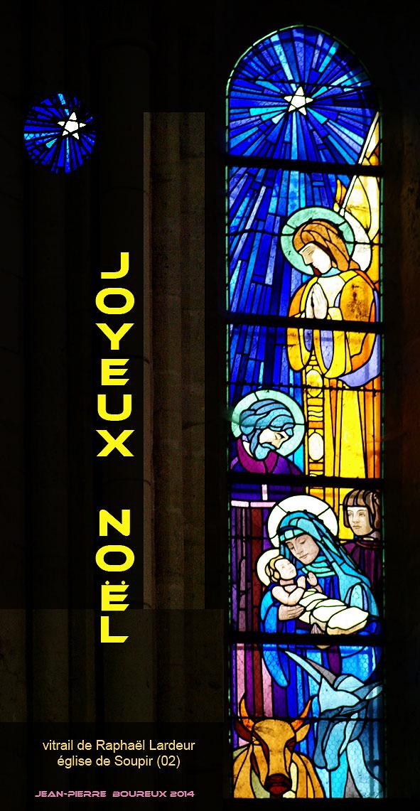 évocation de la Nativité, avec Marie, Jésus, ange, âne, boeuf et étoile sur un vitrail de l'église de Soupir (Aisne) lors de la Reconstruction.